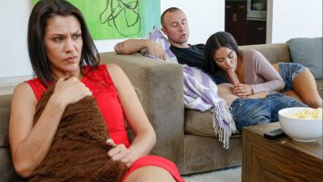 Maya Bijou sucking cock in sofa while stepmom watch tv